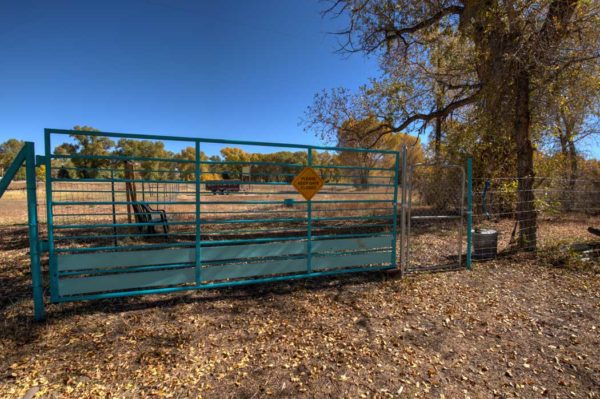 Picture of the gate to the dog run area of Twin Rivers Cabins and RV Park. Everything is there for guests' dogs to run around and enjoy themselves!